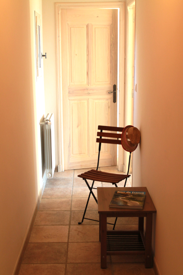 A spacious corridor connects the different rooms