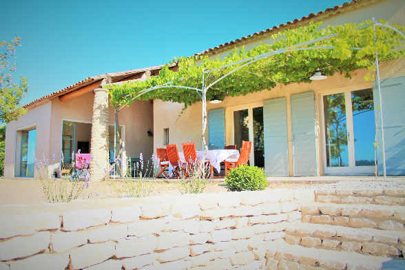 Two huge terraces and a beautiful view on the natural 5.000 sqm of garden - with a giant pool