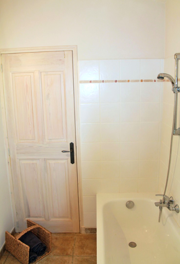 Bathtub and shower in the bathroom close to the master bed room